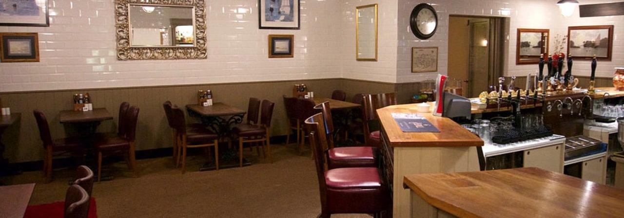 Bar Seating Area At Wayford Bridge Inn