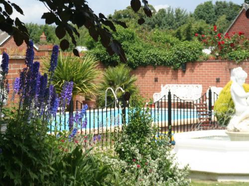 Outdoor swimming pool at The Old Rectory Hotel Crostwick
