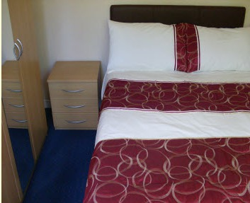 Bedroom of Wentworth Holiday Chalets