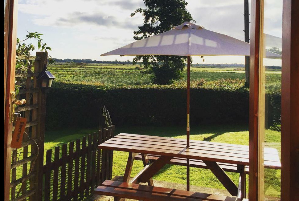Patio and views for Hall Farm Cottages