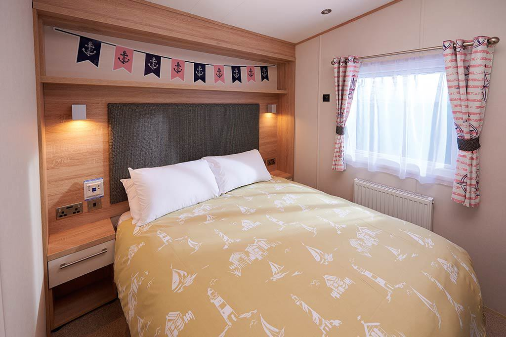 Master Bedroom in caravan at Wild Duck Haven