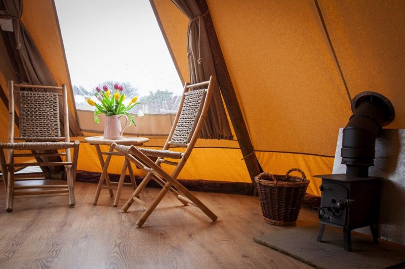 Grand Tipi Seating Area And Woodburner